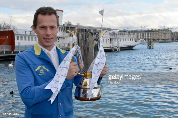 In this handout provided by Rolex Christian Ahlmann of Germany poses with his winners trophy after victory in the Rolex IJRC Top Ten Final on his...