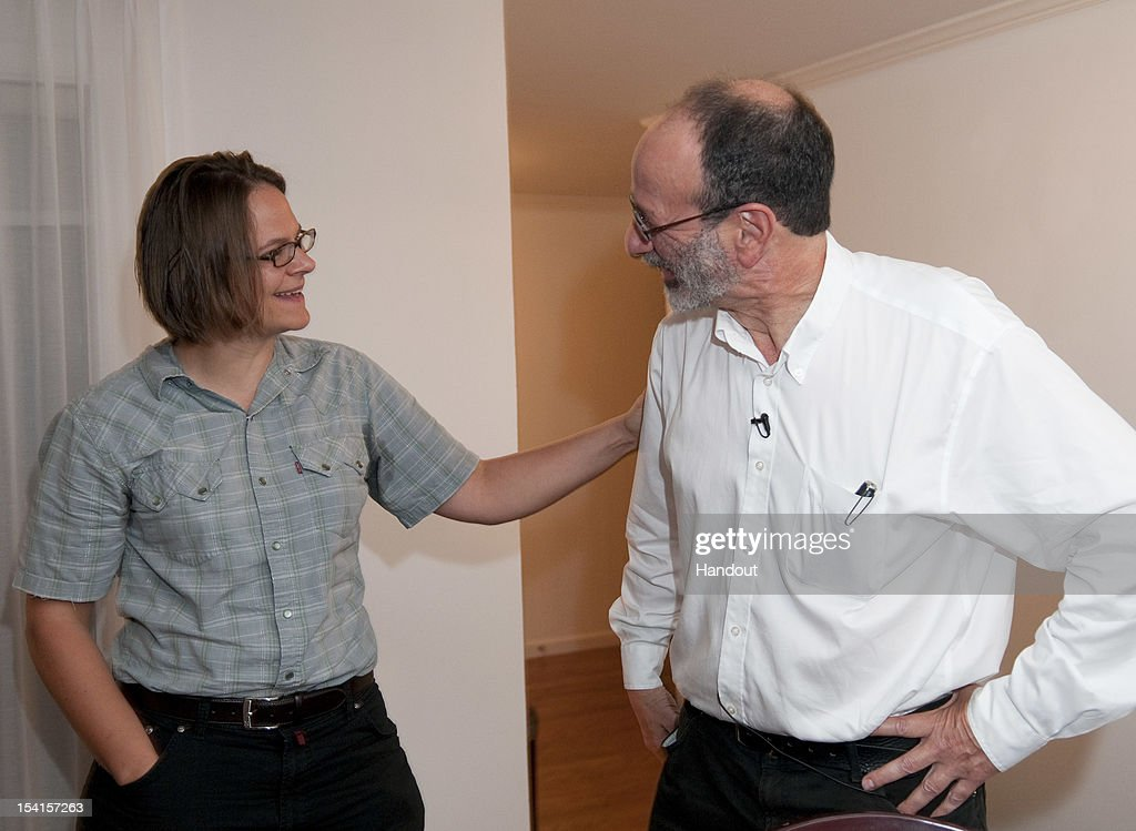 In this handout provided by Stanford University, visiting Harvard professor Alvin Roth who was awarded the Nobel economics prize, is congratulated by Stanford Professor Muriel Niederle who was Roth's first Ph.D. student at Harvard at his home October 15, 2012 in Menlo Park, California. Along with professor emeritus at University of California Los Angeles Lloyd Shapley the pair studied the problems of match-making that takes place when doctors are coupled up with hospitals, students with schools, and human organs with transplant recipients.