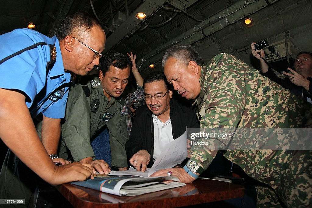 In this handout provided by the Angkatan Tentera Malaysia, Malaysian Royal Navy (TLDM) commander Tan Sri Abdul Aziz Jaafar (left), Lieutenant General Dato' Sri Ackbal bin Hj Abdul Samad (2nd left), Malaysian Defence Minister, Minister of Defence & (Acting) Minister of Transport Dato' Seri Hishammuddin Hussein (2nd right), and Malaysian Defence Forces chief Tan Sri Zulkifeli Mohd Zin discuss their strategy during a search and rescue mission flight on March 11, 2014 in Kuala Lumpur, Malaysia. Officials have expanded the search area for missing Malaysia Airlines flight MH370 to include more of the Gulf of Thailand between Malaysia and Vietnam and land along the Malay Peninsula. The flight carrying 239 passengers from Kuala Lumpur to Thailand was reported missing on the morning of March 8 after the crew failed to check in as scheduled. Relatives of the missing passengers have been advised to prepare for the worst as authorities focus on two passengers on board travelling with stolen passports.
