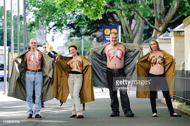 In this handout provided by The Australian Lung Foundation men and women unveil their chests in support for lung health at Wynard Station on October...