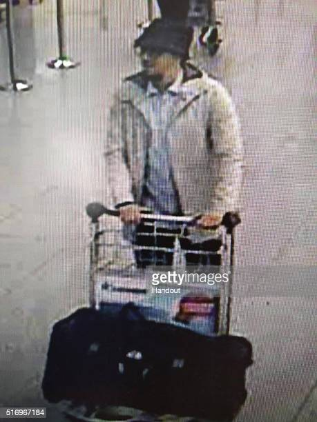 In this handout provided by the Belgian Federal Police a screengrab of the airport CCTV camera shows a suspect from this morning's attacks at...