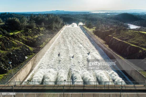 In this handout provided by the California Department of Water Resources Water flows down the Oroville Dam main spillway at 55000 cubic feet per...