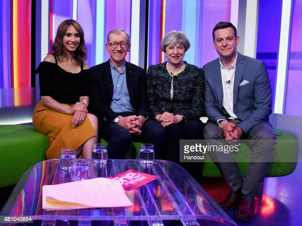In this handout provided by The Conservative Party British Prime Minister Theresa May and her husband Philip May pose with presenters Alex Jones and...