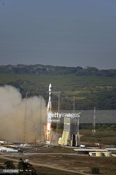 In this handout provided by the European Space Agency a Russianmade Soyuz rocket blasts off from Europe's space base October 12 2012 near Kourou...