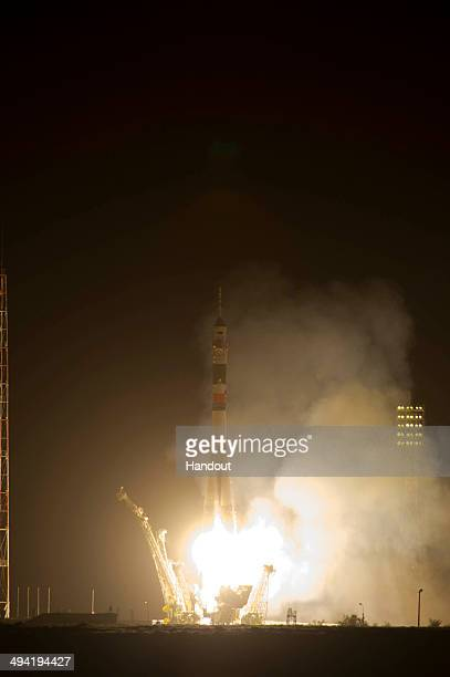 In this handout provided by the European Space Agency Soyuz TMA13M lifts off from the Russian Baikonour cosmodrome May 28 2014 in Baikonur Kazakhstan...
