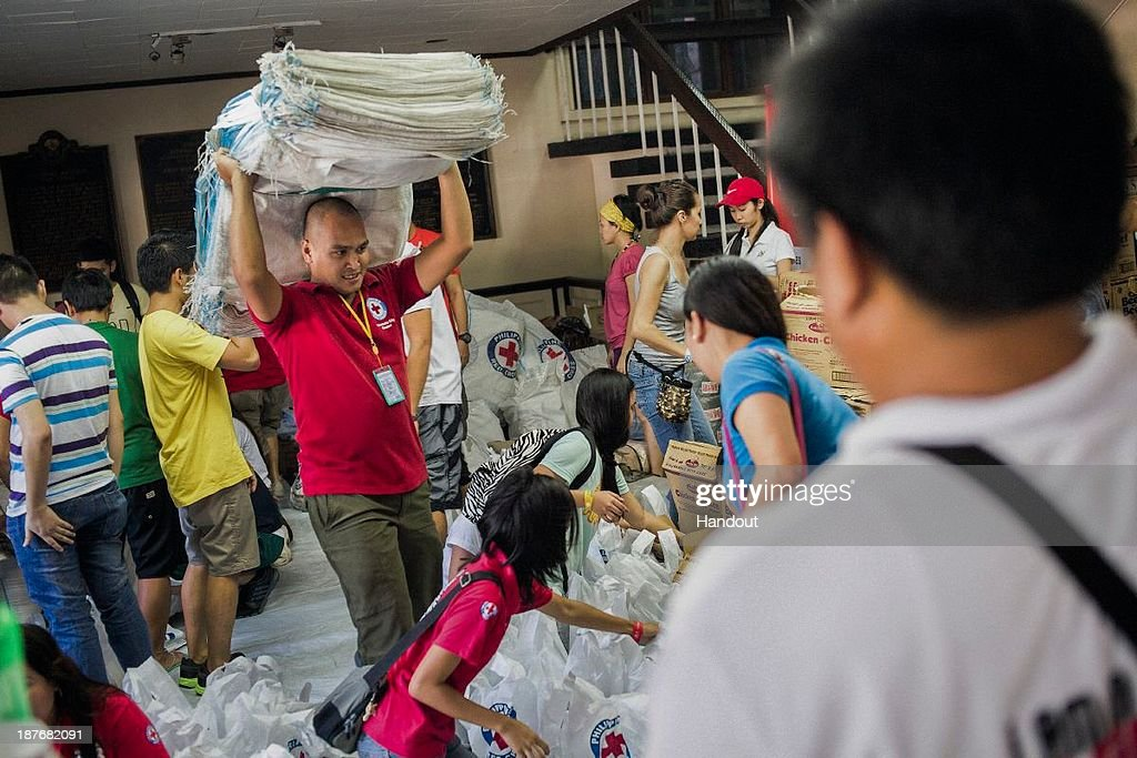 In this handout provided by the Finnish Red Cross, volunteers and staff help to prepare relief supplies for deployment to affected areas in the wake of Typhoon Haiyan, at the Philippine Red Cross Headquarters on November 10, 2013 in Manila, Philippines. Typhoon Haiyan, packing maximum sustained winds of 195 mph (315 kph), slammed into the southern Philippines and left a trail of destruction in multiple provinces, forcing hundreds of thousands to evacuate and making travel by air and land to hard-hit provinces difficult. Around 10,000 people are feared dead in the strongest typhoon to hit the Philippines this year.