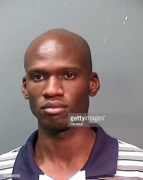 In this handout provided by the Fort Worth Police Department suspect Aaron Alexis poses for a mug shot after being arrested on September 4 2010 for...
