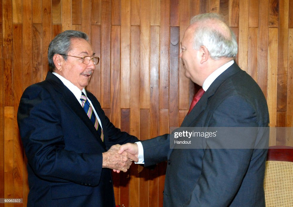 In this handout provided by the government of Cuba, Raul Castro (L), President of Cuba shakes hands with Spain�s Foreign Minister <a gi-track='captionPersonalityLinkClicked' href=/galleries/search?phrase=Miguel+Angel+Moratinos&family=editorial&specificpeople=233820 ng-click='$event.stopPropagation()'>Miguel Angel Moratinos</a> (R) in the State Council, on October 19, 2009, in Havana, Cuba. Moratinos is on a two days visit to Cuba.