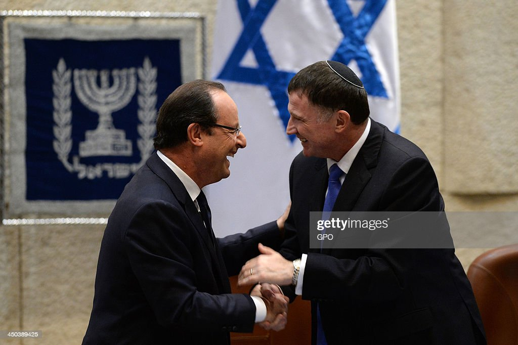 In this handout provided by the GPO, French President Francois Hollande (L) shakes hands with Israeli Knesset Speaker Yuli Edelstein (R) after his speech in the Knesset on November 18, 2013 in Jerusalem, Israel. Francois Hollande is on a three day official visit to Israel and the West Bank.