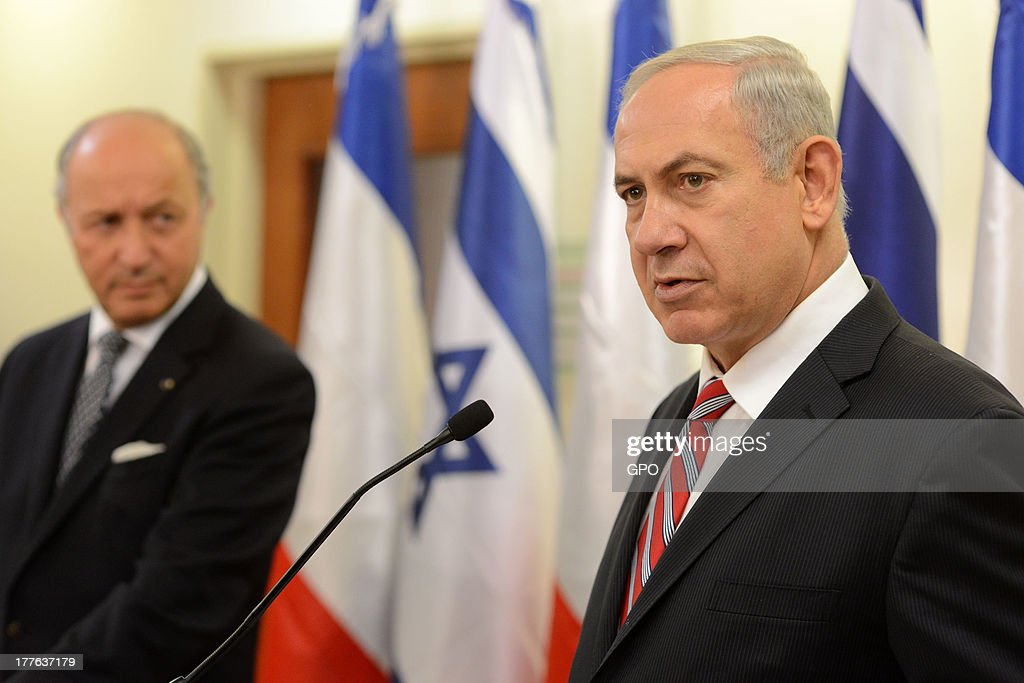 In this handout provided by the GPO, Israel Prime Minister Benjamin Netanyahu (R) speaks during his meeting with the Foreign Minister of France Laurent Fabius at the Prime Minister office August 25, 2013 in Jerusalem, Israel. Israeli and Palestinian negotiators formally resumed direct peace talks earlier this month after a hiatus of nearly three years.