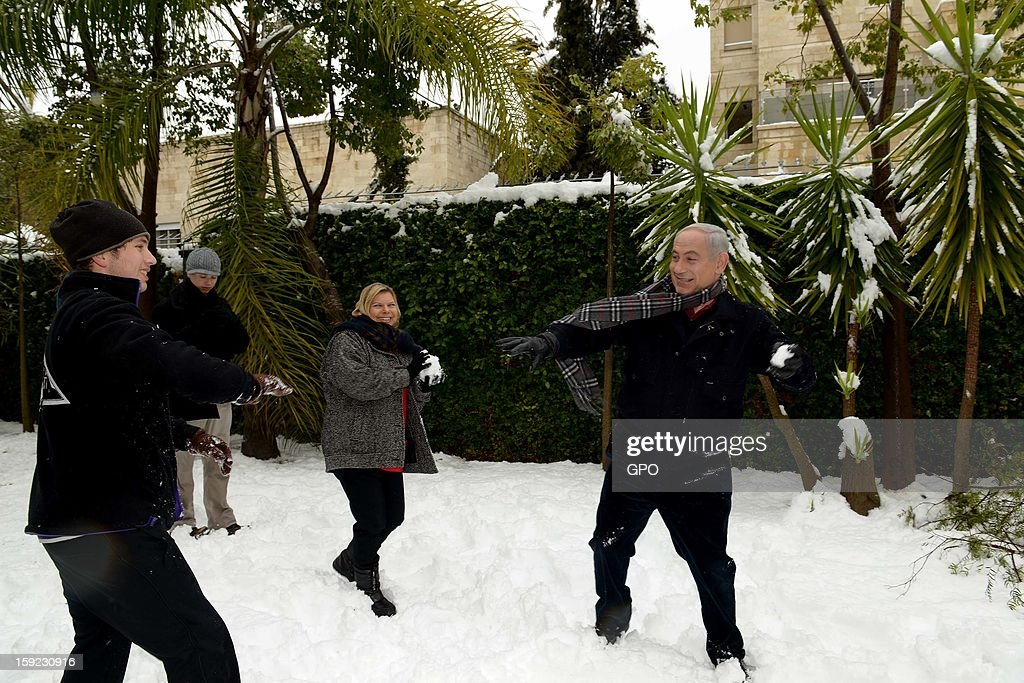 In this handout provided by the GPO, Israeli Prime Minister Benjamin Netanyahu enjoys the snow with his family on January 10, 2013 in Jerusalem, Israel. Snow and strong winds have affected regions across the Middle East.