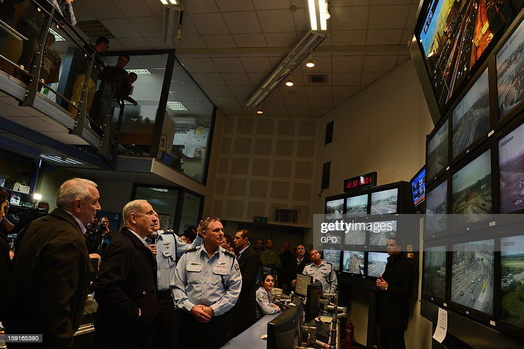 In this handout provided by the GPO, sraeli Prime Minister Benjamin Netanyahu (2nd L), looks at monitors with Internal Security Minister Yitzhak Aharonovitch and Police Commissioner Yohanan Danino during a visit to The National Traffic Police Headquarters on January 09, 2013 in Israel. Netanyahu thanked officers for their efforts during the 'Pillar of Defense' - the seven day IDF operation in the Hamas governed Gaza Strip.