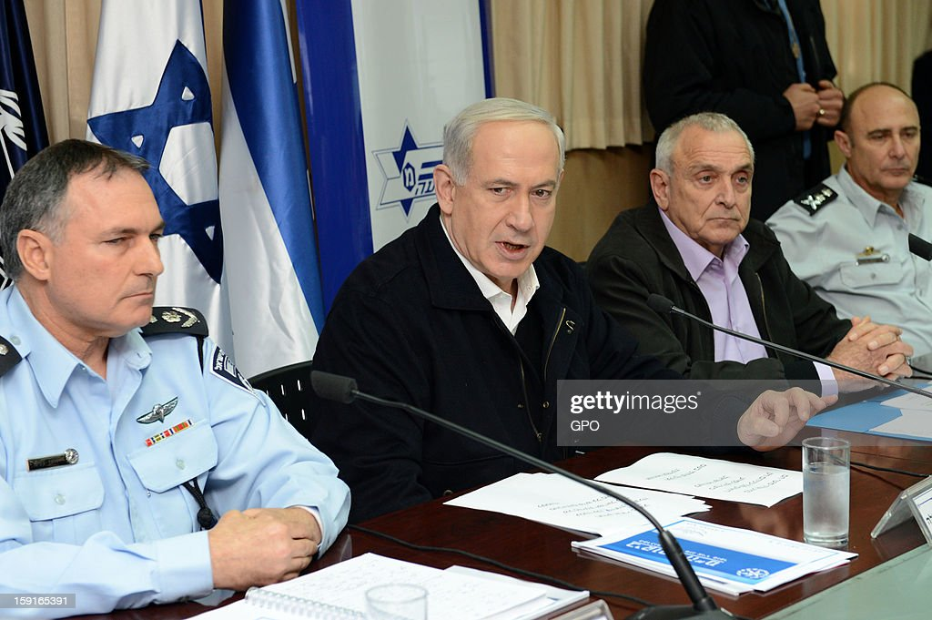 In this handout provided by the GPO, sraeli Prime Minister Benjamin Netanyahu (C), speaks bedide Internal Security Minister Yitzhak Aharonovitch (R), and Police Commissioner Yohanan Danino ( L) during a visit to The National Traffic Police Headquarters on January 09, 2013 in Israel. Netanyahu thanked officers for their efforts during the 'Pillar of Defense' - the seven day IDF operation in the Hamas governed Gaza Strip.
