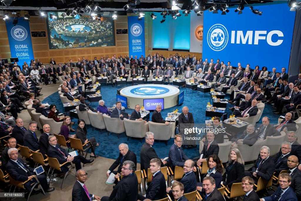 In this handout provided by the IMF, IMFC members pose for a photograph April 22, 2017 at the IMF Headquarters in Washington, DC. The IMF/World Bank Spring Meetings are being held in Washington this week.