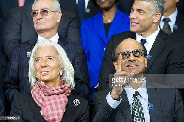 In this handout provided by the International Monetary Fund IMF Managing Director Christine Lagarde and Finance Minister Tharman Shanmugaratnam of...