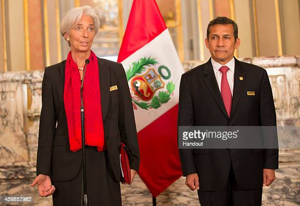 In this handout provided by the International Monetary Fund Managing Director Christine Lagarde and Peru President Ollanta Humala stand before the...