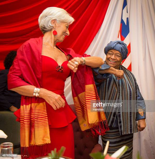 In this handout provided by the International Monetary Fund Managing Director Christine Lagarde is greeted by Liberian President Ellen Johnson...