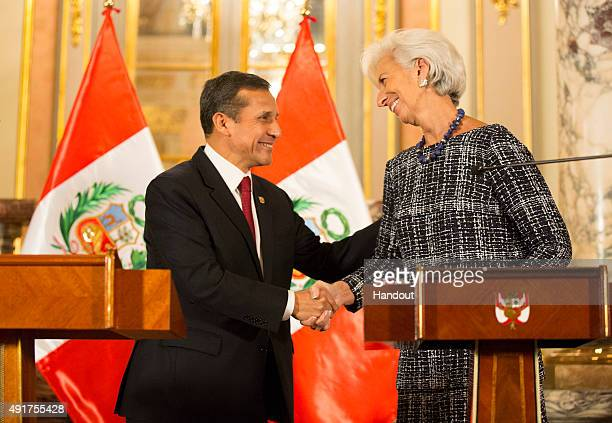 In this handout provided by the International Monetary Fund Managing Director Christine Lagarde shakes hands with Peru President Ollanta Humala at...