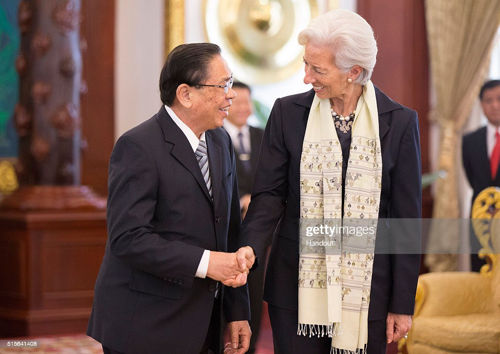 In this handout provided by the International Monetary Fund, Managing Director <a gi-track='captionPersonalityLinkClicked' href=/galleries/search?phrase=Christine+Lagarde&family=editorial&specificpeople=566337 ng-click='$event.stopPropagation()'>Christine Lagarde</a> (R) is greeted by President <a gi-track='captionPersonalityLinkClicked' href=/galleries/search?phrase=Choummaly+Sayasone&family=editorial&specificpeople=556173 ng-click='$event.stopPropagation()'>Choummaly Sayasone</a> (L) of Laos March 15, 2016 in Vientiane, Laos. (Photo by Stephen Jaffe/IMF via Getty Images