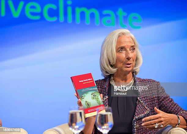 In this handout provided by the International Monetary Fund International Monetary Fund Managing Director Christine Lagarde participates in a Program...