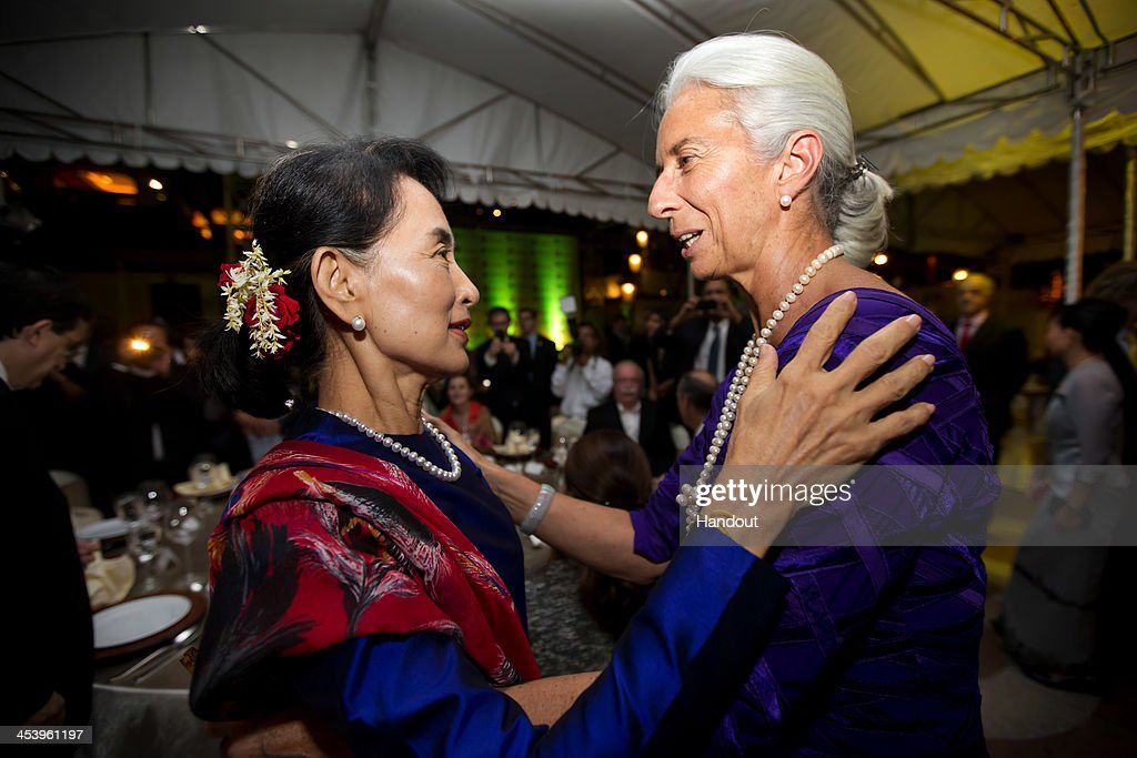 In this handout provided by the International Monetary Fund (IMF), International Monetary Fund Managing Director Christine Lagarde (R) greets Aung San Suu Kyi (L) at the gala dinner at the women's forum at the Chatrium Hotel December 6, 2013 in Yangon, Myanmar. Lagarde is on a three country visit to Asia.