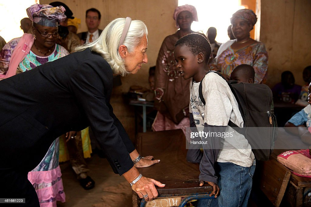 In this handout provided by the International Monetary Fund (IMF), International Monetary Fund Managing Director Christine Lagarde speaks with a pupil during a visit to a primary school on January 10, 2014 in Bamako, Mali. Lagarde is on a two country visit to Africa.