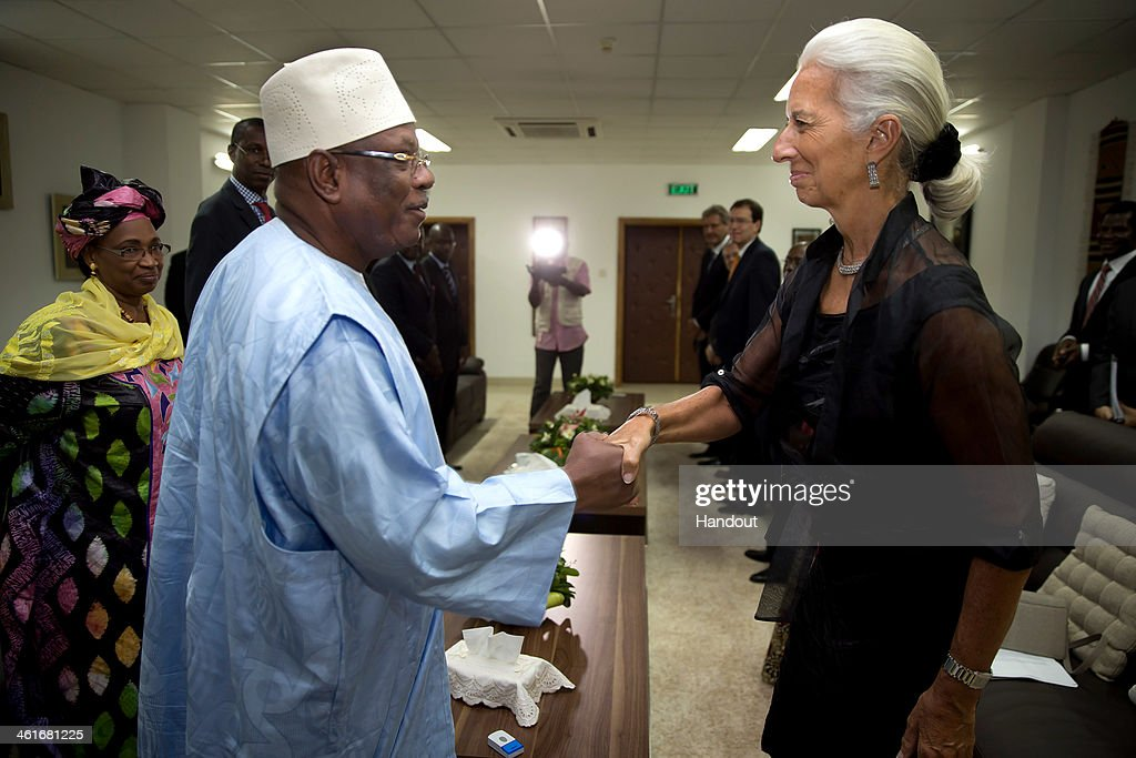 In this handout provided by the International Monetary Fund (IMF), International Monetary Fund Managing Director <a gi-track='captionPersonalityLinkClicked' href=/galleries/search?phrase=Christine+Lagarde&family=editorial&specificpeople=566337 ng-click='$event.stopPropagation()'>Christine Lagarde</a> meets with Mali's President Ibrahim Boubacar Keita at the Presidency on January 9, 2014 in Bamako, Mali. Lagarde is on a two country visit to Africa.