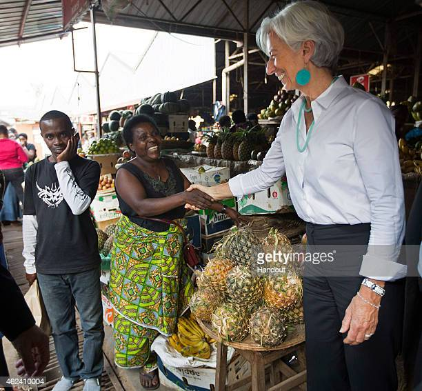 In this handout provided by the International Monetary Fund International Monetary Fund Managing Director Christine Lagarde is greeted at the...