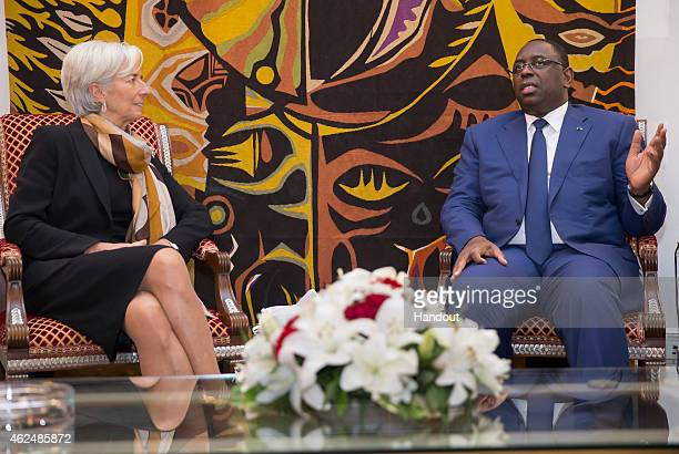 In this handout provided by the International Monetary Fund International Monetary Fund Managing Director Christine Lagarde meets with Senegalese...