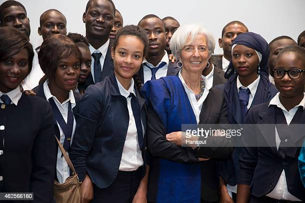 In this handout provided by the International Monetary Fund International Monetary Fund Managing Director Christine Lagarde meets students during a...
