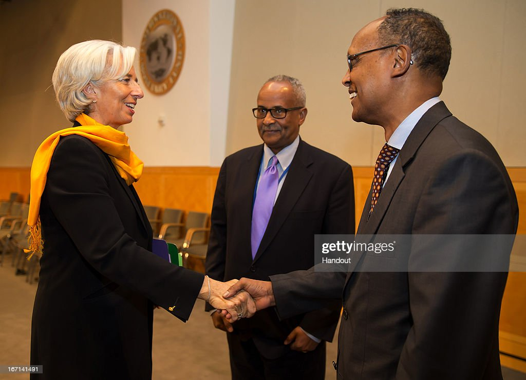 In this handout provided by the International Money Fund (IMF),IMF Managing Director <a gi-track='captionPersonalityLinkClicked' href=/galleries/search?phrase=Christine+Lagarde&family=editorial&specificpeople=566337 ng-click='$event.stopPropagation()'>Christine Lagarde</a> (L) greets Somalia's Minister of Finance Mohamud Hassan Suleiman (R) as Somalia's Bank Governor Abdusalam Omer (C) looks on during a meeting with members of MENA, Middle East and North Africa, April 21, 2013 at the IMF Headquarters in Washington, DC. The IMF/World Bank Meetings are being held in Washington, DC.