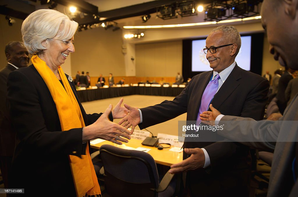 In this handout provided by the International Money Fund (IMF), IMF Managing Director <a gi-track='captionPersonalityLinkClicked' href=/galleries/search?phrase=Christine+Lagarde&family=editorial&specificpeople=566337 ng-click='$event.stopPropagation()'>Christine Lagarde</a> (L) greets Somalia's Bank Governor Abdusalam Omer (R) during a meeting with members of MENA, Middle East and North Africa, April 21, 2013 at the IMF Headquarters in Washington, DC. The IMF/World Bank Meetings are being held in Washington, DC.