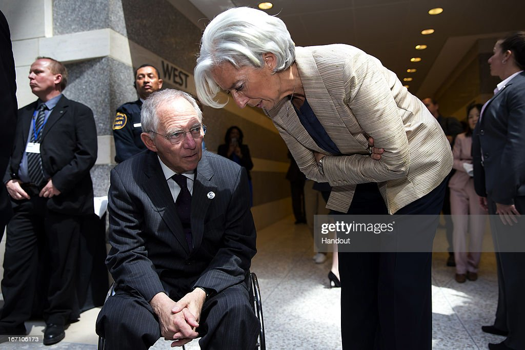 In this handout provided by the International Money Fund (IMF), International Monetary Fund Managing Director <a gi-track='captionPersonalityLinkClicked' href=/galleries/search?phrase=Christine+Lagarde&family=editorial&specificpeople=566337 ng-click='$event.stopPropagation()'>Christine Lagarde</a> (R) speaks the German Finance Minister Wolfgang Schauble (L) during a break from the IMFC meeting as Finance Ministers and Bank Governors meet at the IMF Headquarters April 20, 2013 in Washington, DC. The ministers and governors are attending the IMF/World Bank Spring Meetings in Washington.