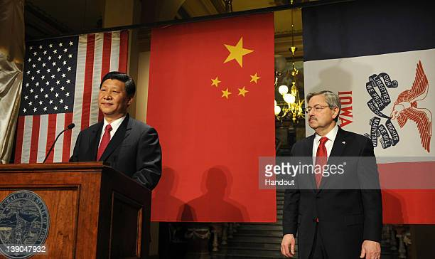 In this handout provided by the Iowa Governor's Office Vice President Xi Jinping of the People's Republic of China speaks as Iowa Gov Terry Branstad...
