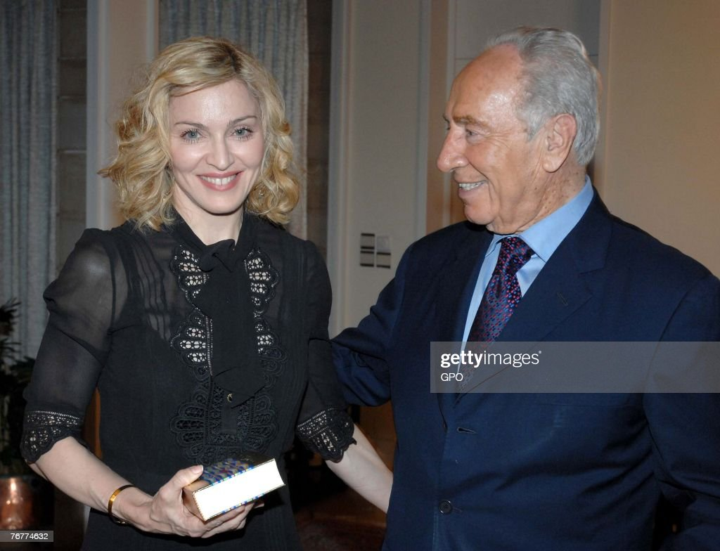 In this handout provided by the Israeli Government Press Office (GPO), actress and singer Madonna presents Israeli President Shimon Peres With a Kabbalah book September 15, 2007 in Jerusalem, Israel.