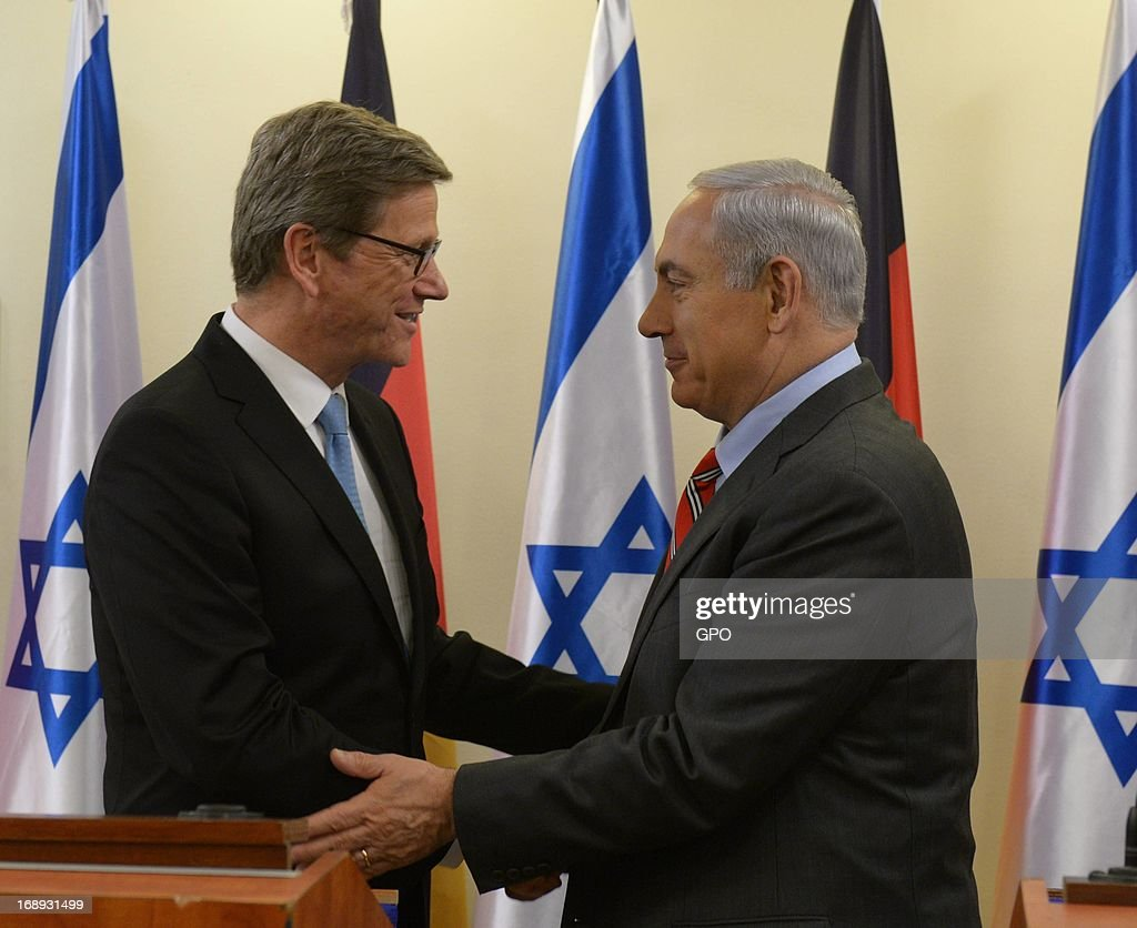 In this handout provided by the Israeli Government Press Office (GPO), Israeli Prime Minister Benjamin Netanyahu (R) greets German Foreign Minister Guido Westerwelle before their meeting on May 17, 2013 in Jerusalem, Israel. Westerwelle is on two-day trip to Israel and the Palestinian territories, aimed at promoting a new start to peace talks.