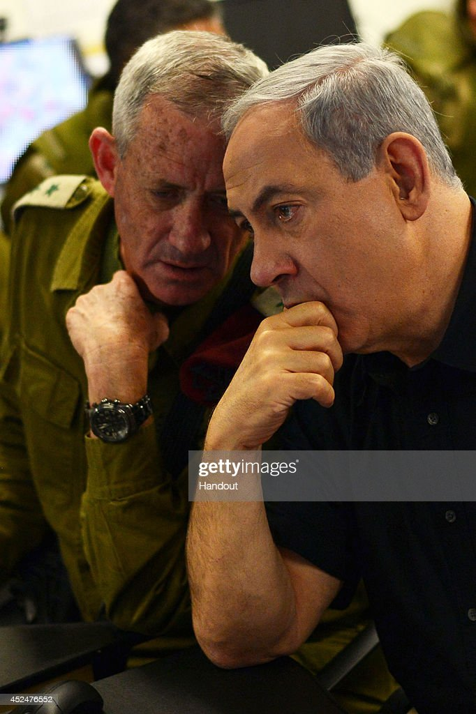 In this handout provided by the Israeli Government Press Office, Israel Prime Minister Benjamin Netanyahu (R) and IDF Chief of Staff Benny Gantz visit a tactical headquarters of the IDF in southern Israel near the border with Gaza on July 21, 2014 in near Beersheba, Israel. Yesterday marked the bloodiest day of the conflict yet, as 13 Israeli soldiers died and the death toll in Gaza passed 500 people.