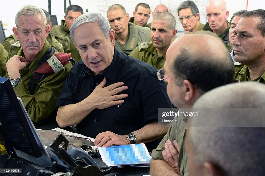 In this handout provided by the Israeli Government Press Office, Israeli Prime Minister Benjamin Netanyahu (C), and IDF Chief of Staff Benny Gantz (L) visit a tactical headquarters of the IDF in southern Israel near the border with Gaza on July 21, 2014 in near Beersheba, Israel. Yesterday marked the bloodiest day of the conflict yet, as 13 Israeli soldiers died and the death toll in Gaza passed 500 people.