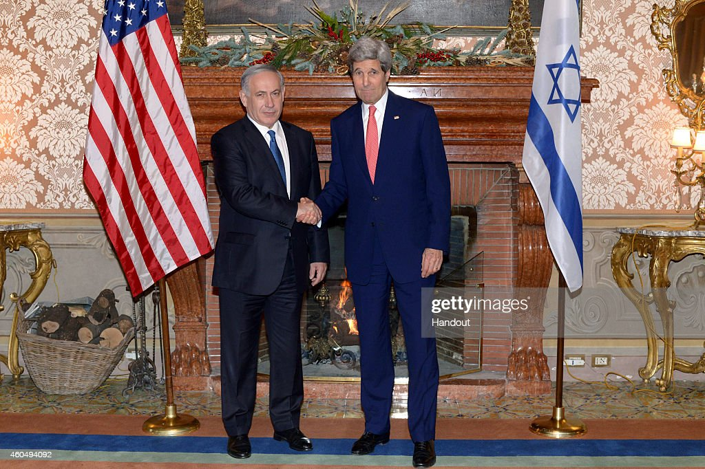 In this handout provided by the Israeli Government Press Office, Israel Prime Minister Benjamin Netanyahu (L) shakes hands with U.S. Secretary of State <a gi-track='captionPersonalityLinkClicked' href=/galleries/search?phrase=John+Kerry&family=editorial&specificpeople=154885 ng-click='$event.stopPropagation()'>John Kerry</a> as they meet December 15, 2014 in Rome, Italy. Palestinians officials announced they will put a resolution before the U.N. Security Council outlining November 2016 as a deadline for an Israeli retreat from land sought for a Palestinian state.