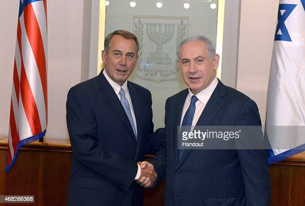 In this handout provided by the Israeli Government Press Office Israel Prime Minister Benjamin Netanyahu shakes hands with US House Speaker John...