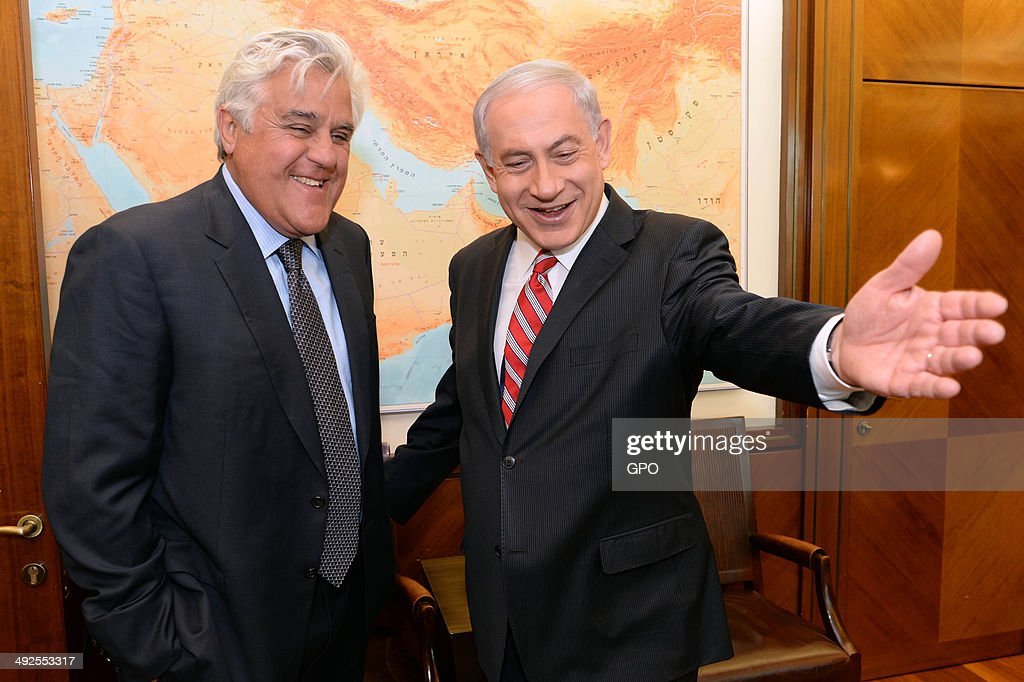 In this handout provided by the Israeli Government Press Office Israeli Prime minister Benjamin Netanyahu meets American comedian Jay Leno in his...