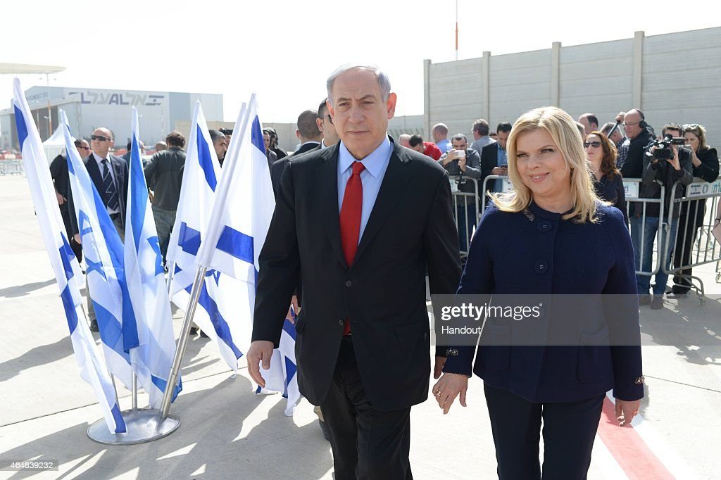 In this handout provided by the Israeli Government Press Office, Prime Minister Benjamin Netanyahu and his wife Sarah leave Tel Aviv on their way to Washington DC, on March 1, 2015 in Tel Aviv, Israel.