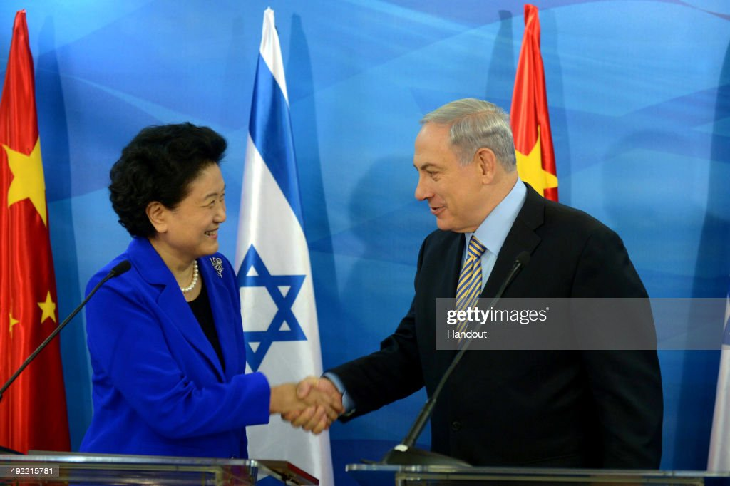 In this handout provided by the Israeli Government Press Office, Prime Minister of Israel, Benjamin Netanyahu greets Chinese Vice Prime Minister <a gi-track='captionPersonalityLinkClicked' href=/galleries/search?phrase=Liu+Yandong&family=editorial&specificpeople=4375362 ng-click='$event.stopPropagation()'>Liu Yandong</a> during a meeting on May 19, 2014 in Jerusalem, Israel. Chinese Vice Prime Minister is on an official visit to Israel from May 18th to 22nd.