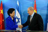 In this handout provided by the Israeli Government Press Office Prime Minister of Israel Benjamin Netanyahu greets Chinese Vice Prime Minister Liu...