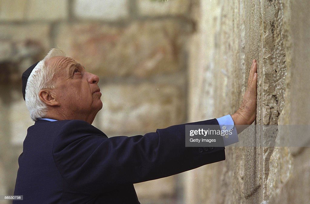 In this handout provided by the Israeli Governmental Press Office Israeli Prime Minister elect Ariel Sharon prays the day after his election victory...