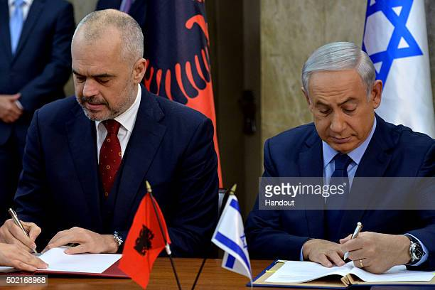 In this handout provided by the Israeli GPO Israel's Prime Minister Benjaim Netanyahu and Edi Rama the Prime Minister of Albania sign cooperation...