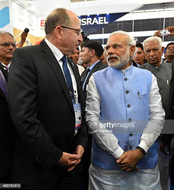 In this handout provided by the Israeli Ministry of Defence Israeli Defense Minister Moshe Ya'alon visits the arms exhibition in India with Indian...