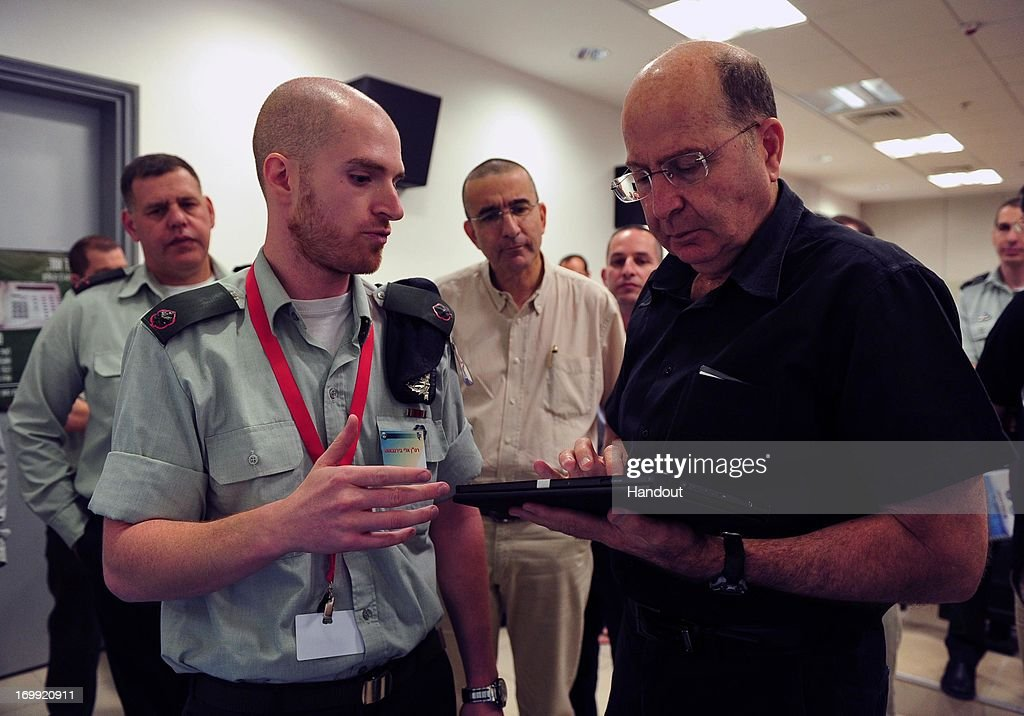 In this handout provided by the Israeli Ministry of Defense, Defense Minister Moshe Ya'alon visits the Telecom and Cyber System on June 4, 2013 in Isreal.