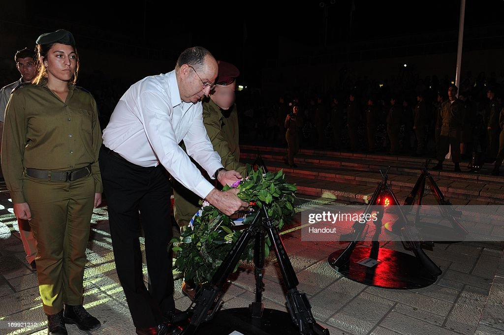In this handout provided by the Israeli Ministry of Defense, Defense Minister Moshe Ya'alon lays a wreath during a ritual with the intelligence community on June 4, 2013 in Isreal.