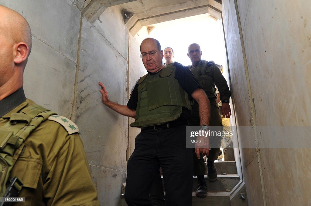 In this handout provided by the Israeli Ministry of Defense, Israeli Defense Minister Moshe Ya'alon (C) tours the recently discovered tunnel linking Gaza to Israel while visiting the Southern Command and the Gaza Division October 29, 2013 along the Israeli border with Gaza. Ya'alon reassured Israelis after the discovery of the tunnel that security on the southern border was strong.